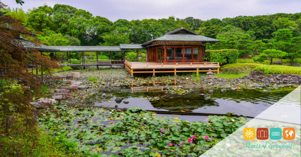 Idyllic landscape of Japanese garden with wooden house at summer day.