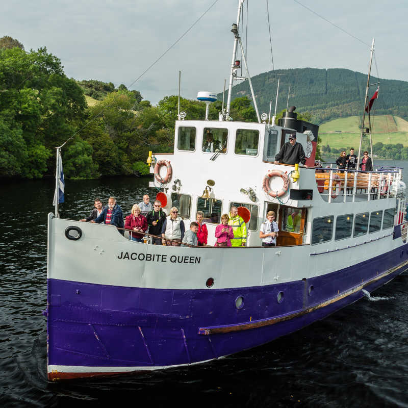 Loch Ness, Urquhart Castle, Scotland, UK - September 19, 2014: a Jacobite Cruises boat on approach to Urquhart Castle dock. Their ships carry tourists on sightseeing tours around Loch Ness shores.