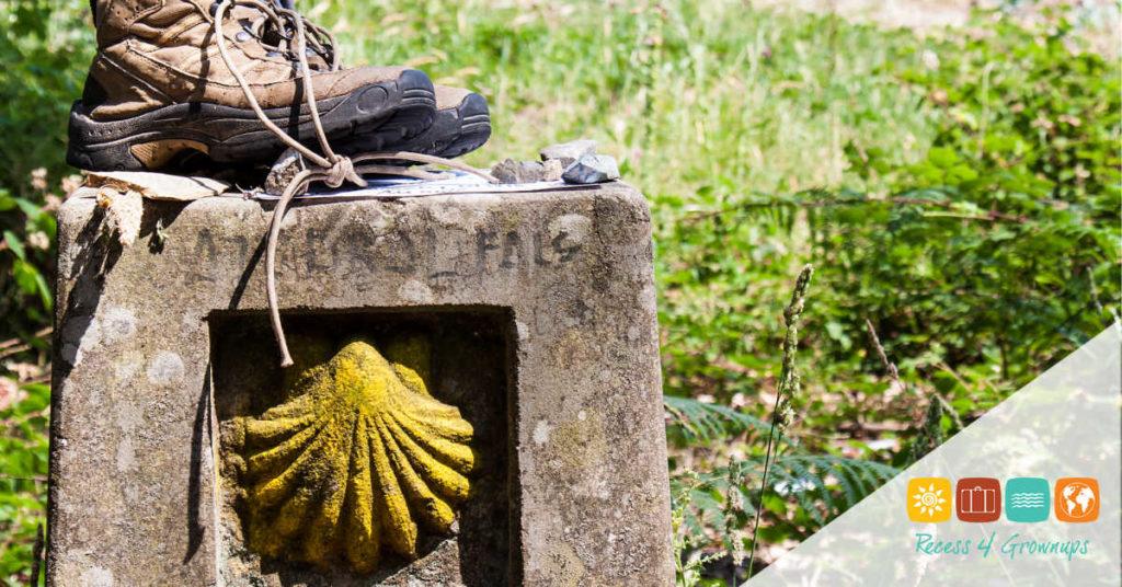 Boots on a landmark of Camino de Santiago