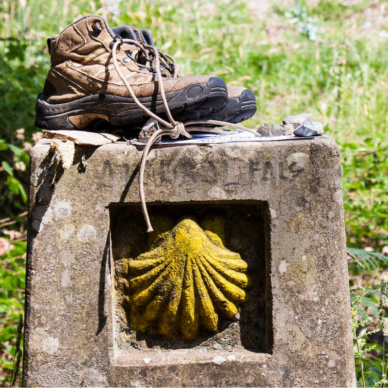 Boots on a landmark of Camino de Santiago
